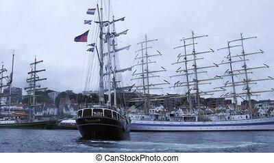 Ship docks in front of MIR barque to sea regatta -...