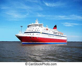 one big bright ferry floating by sea