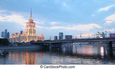 Ship floats near Novoarbatsky bridge with high-rise building...