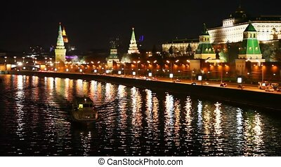 ship floats on the river near to Kremlin walls and roads in Moscow