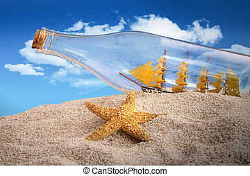 Ship in a bottle in a pile of sand - Ship in a bottle on...