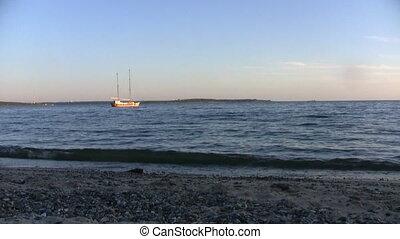 Ship in a calm sea view form beach
