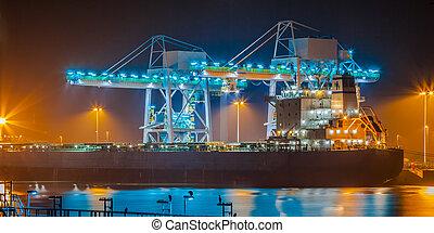 Ship in a harbor at night