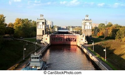Ship in front of gate of sluice number 8 Moscow Canal in Moscow, Russia