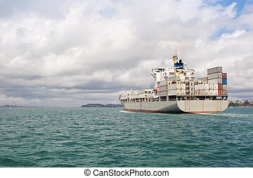 A ship leaves Auckland Harbour in the Hauraki Gulf, New Zealand