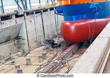Ship in shipyard's covered dry dock