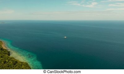 Ship in the blue sea against the sky Philippines, Mindanao -...