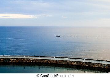 Ship in the blue sea twilight