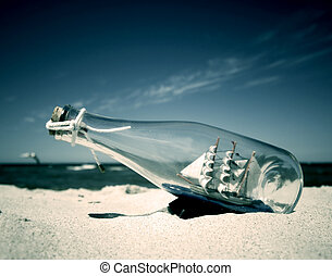 Ship in the bottle - Bottle with ship inside lying on the...
