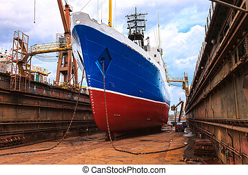 Ship in the floating dock - Cargo ship is being renovated in...