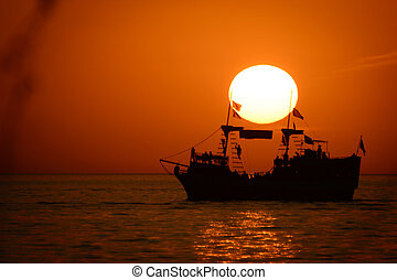 Ship in the ocean - Silhouette of sailing ship in the...