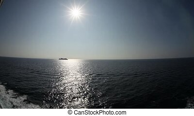 Ship in the sea and the sun. Very wide lens
