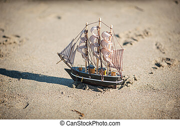 ship is a toy in the sand