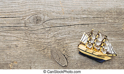 ship model on wood background