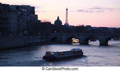 Ship moves on river to stone bridge