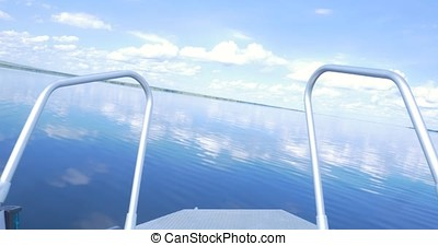 Ship Nose Front View boat at sea. view from motorboat. Elegant modern motor boat is at the dock in the bay river summer day