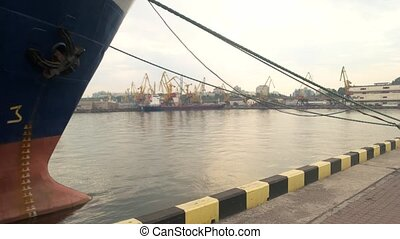 Ship nose with anchor. Port and sky. Maritime industry...