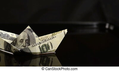 Ship of 100 dollars floating in the sea of oil.