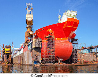 Ship on a dry dock - Ship bow forward on dry dock i...