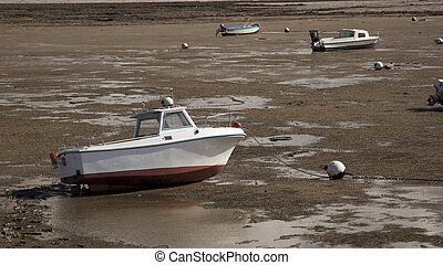 ship on the beach at low tide