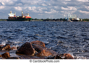 Ship passes by on the river to the sea port