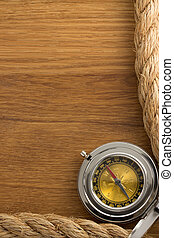 ship ropes and compass at old wood