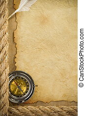ship ropes and compass at parchment