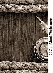 ship ropes and compass at wood