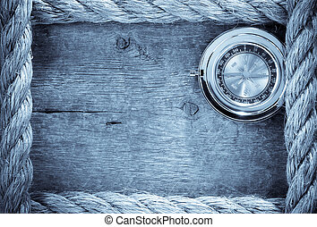 ship ropes and compass with pen on old vintage wooden ...