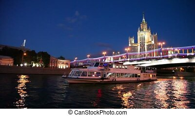Ship sail down the river, high-rise building of the Stalin...