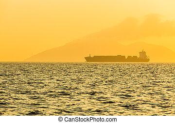 Ship sailing at the ocean
