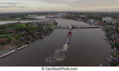 Ship sailing through drawbridge, aerial view