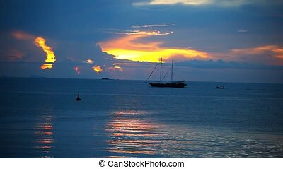 Ship sails on a background of beautiful sunset. Video