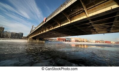 Ship sails under Crimean bridge and move to other side,...