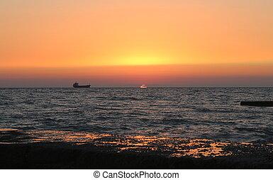 Ship, sea, sunset.