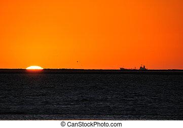 Ship silhouette against sunset at Walvisbaai, Namibia