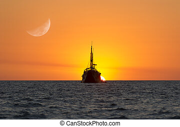 Ship Silhouette is a large old wooden ship sitting on the...