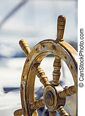 ship steering - a sailboat, antique wood steering wheel,...