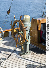 Ship steering wheel - A wooden steering wheel on a sailboat