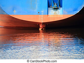 Ship stern with reflection in harbor water