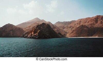Ship travel sails along Musandam peninsula, Sultanate of...