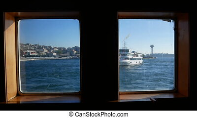 Ship window sea waves - A view through a ship's porthole on...