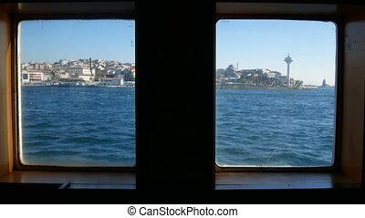 Ship window sea waves - A view through a ship's porthole on...