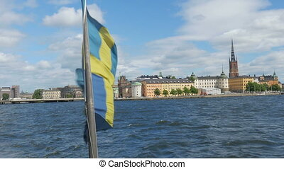 """""""ship with swedish flag leaving from old city, stockholm,..."""