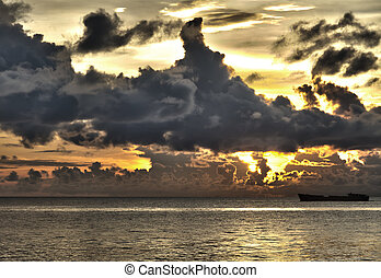 Ship with threatening clouds over South China Sea at Phu Quoc, Vietnam