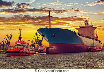Ship with tugs - Big ship with escorting tugs leaving port ...