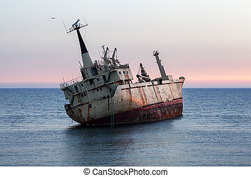Ship wreck at sunset - Sinking ship wreck at sunset
