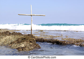 Ship Wreck Memorial - A small wooden cross on a reef, for...