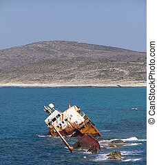 ship wreck - sunken ship washed ashore, Milos island, Greece