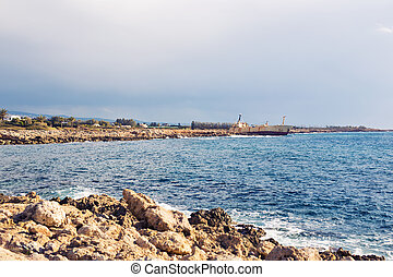 Ship wreck surrounded by sea waves on beach, Cyprus.
